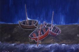 Drei Boote am Strand